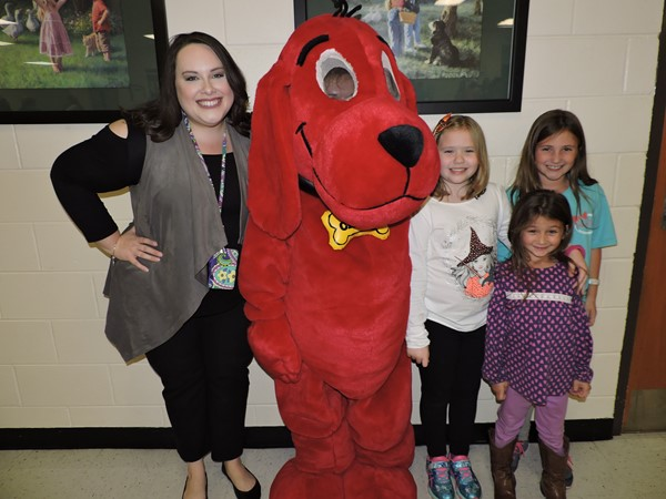 Mrs. Dula poses with a few of her students and a special guest, Clifford the Big Red Dog.