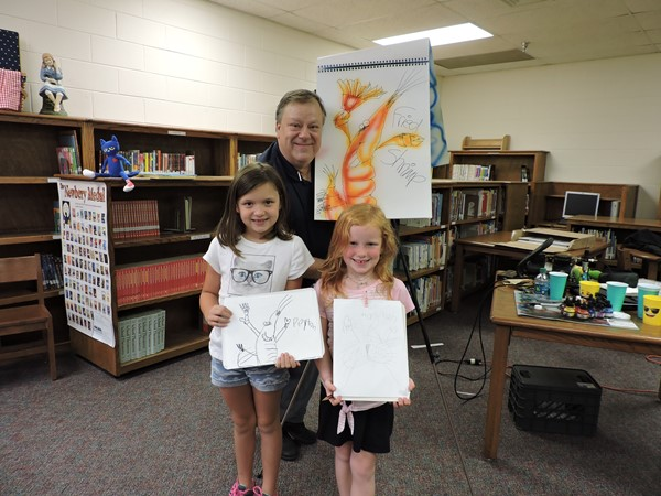 Students and staff enjoying a visit by book illustrator Michael P. White sponsored by local Friends of the Library.